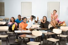Highschool students messing in class during break Royalty Free Stock Images