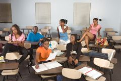 Highschool students messing in class during break Stock Images