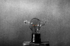 Highspeed capture of an red glowing light bulb shattered to peaces stock images