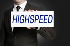 Highspeed sign is held by businessman Royalty Free Stock Images