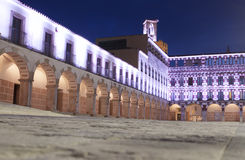 Hight square illuminated by led lights, Spain. Hight square of Badajoz,  illuminated by led lights at twilight. Low angle view from the floor Stock Photo