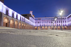 Hight square illuminated by led lights, Spain. Hight square of Badajoz,  illuminated by led lights at twilight. Low angle view from the floor Royalty Free Stock Photos
