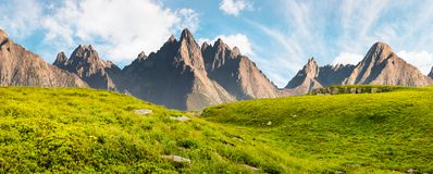 Huge stones in valley on top of mountain range. Hight Tatra mountain summer landscape composite image. grassy meadow with stones on top of the hillside near the Royalty Free Stock Photography