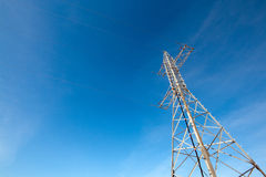 Hight voltage electrical tower against blue sky Stock Image