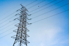 Hight Voltage Electricity post on Blue Sky Stock Images