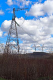 Hight voltage. Iron line and blue sky with clouds Royalty Free Stock Photos