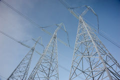 Hight voltage power transmission tower stock photography