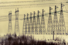 Hight voltage power transmission tower. Power supply and energetics concept. Toned stock photo