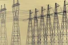 Hight voltage power transmission tower. Power supply and energetics concept. Toned royalty free stock photo