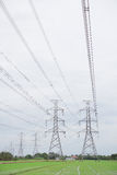 Hight voltage tower line on the cloudy sky background. Stock Image