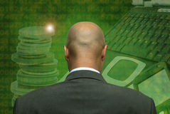 Hightech. Man's head in green background with numbers royalty free stock photography