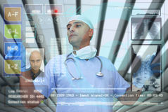 Hightech doctor. Doctor with hightech computer screen viewing patient data Stock Image