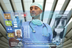 Hightech doctor. Doctor with hightech computer screen viewing patient data stock photography