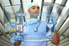 Hightech doctor. Doctor with hightech computer screen viewing patient data Stock Photos