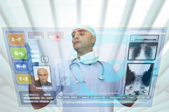 Hightech doctor. Doctor with hightech computer screen viewing patient data Stock Photo