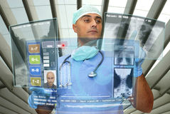 Hightech doctor. Doctor with hightech computer screen viewing patient data Royalty Free Stock Photo
