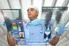 Hightech doctor. Doctor with hightech computer screen viewing patient data Royalty Free Stock Photos