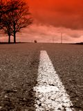 Highway. Road and red sky Stock Images