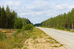 Highway. Through a wood - modern urban landscape stock photo