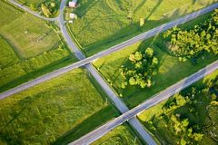 Highway. S in the country with farmland Royalty Free Stock Photos