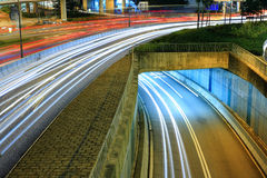 Highway. In city at night with trails of car lights Royalty Free Stock Photography