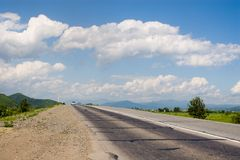 Highway. Fine landscape in a sunny day.Country road Royalty Free Stock Photo