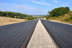 Highway. A highway under construction with its bitumen Stock Photo