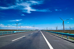 Highway. The highway near Wind turbines Royalty Free Stock Photos