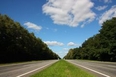 Highway. Road receding into the distance and trees create a geometric perspective stock photos