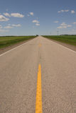 Highway. A yellow strip leads view through the road into the distance Royalty Free Stock Photos