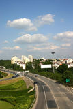 Highway. Four-laned highway near buildings in a town Royalty Free Stock Photography