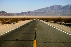 Highway. Stretched through death valley desert Royalty Free Stock Photo
