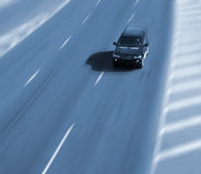 Highway. Fast driving car on a highway royalty free stock photo