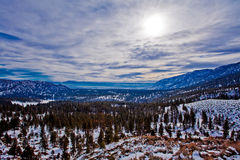 Highway 50, winter day, snow trees and cludy sky Royalty Free Stock Photography