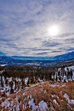 Highway 50, winter day, snow trees and cludy sky Royalty Free Stock Images