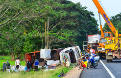 Highway accident. SISAKET,THAILAND - AUGUST 20 ; A rice truck turned over on August 20, 2013 at the Highway 24 on the way to Ubon ratchathani from Sisaket royalty free stock photos