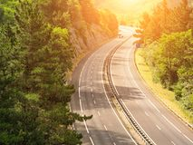 Highway across forested landscape. A highway across forested landscape Royalty Free Stock Photo