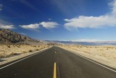 Highway across Mojave Desert Royalty Free Stock Photo