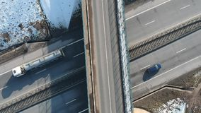 On the highway. Aerial view above a small intersection on the highway circulating by cars stock footage