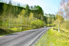 Highway along hill in spring Stock Photography