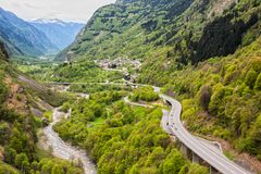 Highway in the Alps, Switzerland. View from the castle of Mesocco on the highway and the town of Soazza in the valley of the river Moesa, Switzerland stock photo