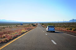 The highway through Arizona desert land Stock Images