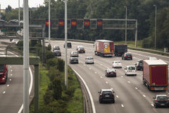 The highway around Antwerp with cars. ANTWERP, BELGIUM – CIRCA AUGUST 2015: The highway (ring) around Antwerp in Belgium with cars and speed signals Stock Photo