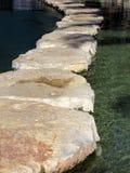 Highway as to stones. Through water stock photos