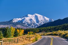Highway at autumn in Colorado, USA. Highway in Colorado at autumn, USA. Mount Sopris landscape royalty free stock photo