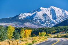 Highway at autumn in Colorado, USA. Highway in Colorado at autumn, USA. Mount Sopris landscape royalty free stock photography