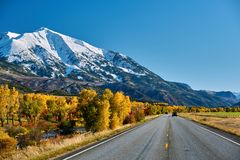 Highway at autumn in Colorado, USA. Highway in Colorado Rocky Mountains at autumn, USA. Mount Sopris landscape stock photography