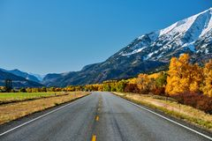 Highway at autumn in Colorado, USA. Highway in Colorado Rocky Mountains at autumn, USA. Mount Sopris landscape royalty free stock photography