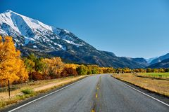 Highway at autumn in Colorado, USA. Highway in Colorado Rocky Mountains at autumn, USA. Mount Sopris landscape stock photo