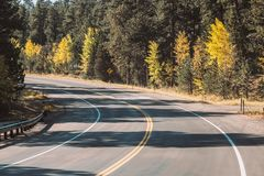 Highway at autumn in Colorado, USA. Royalty Free Stock Photos